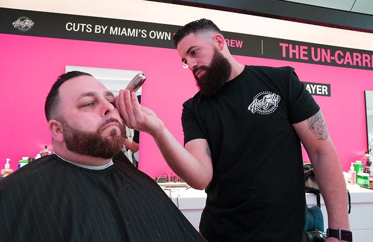 Image of man receiving free haircut from T-Mobile