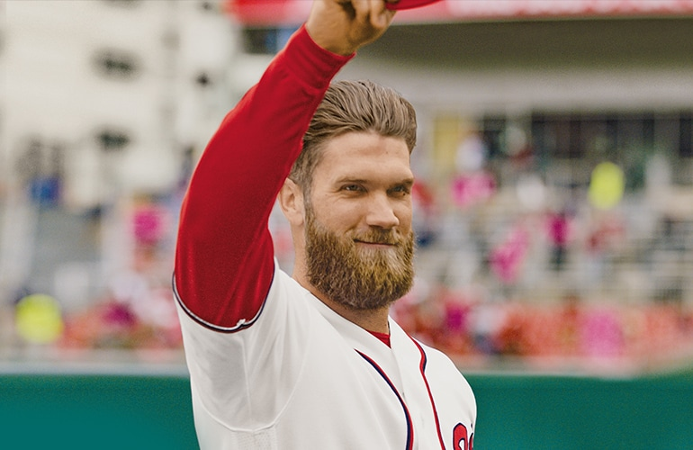 Bryce Harper tipping his hat to the fans.