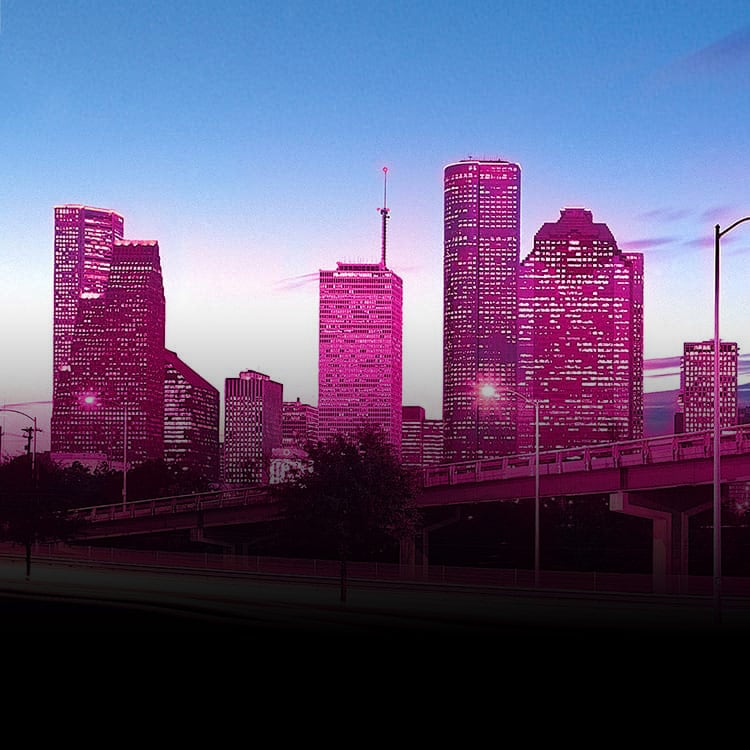 Magenta city skyline at dusk
