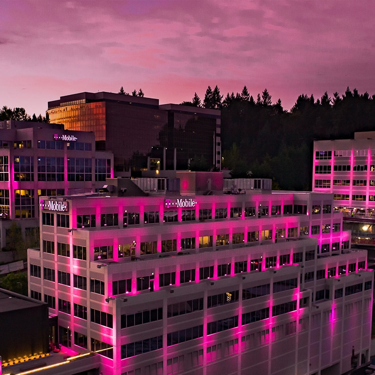 T-Mobile headquarters lite up in magenta.