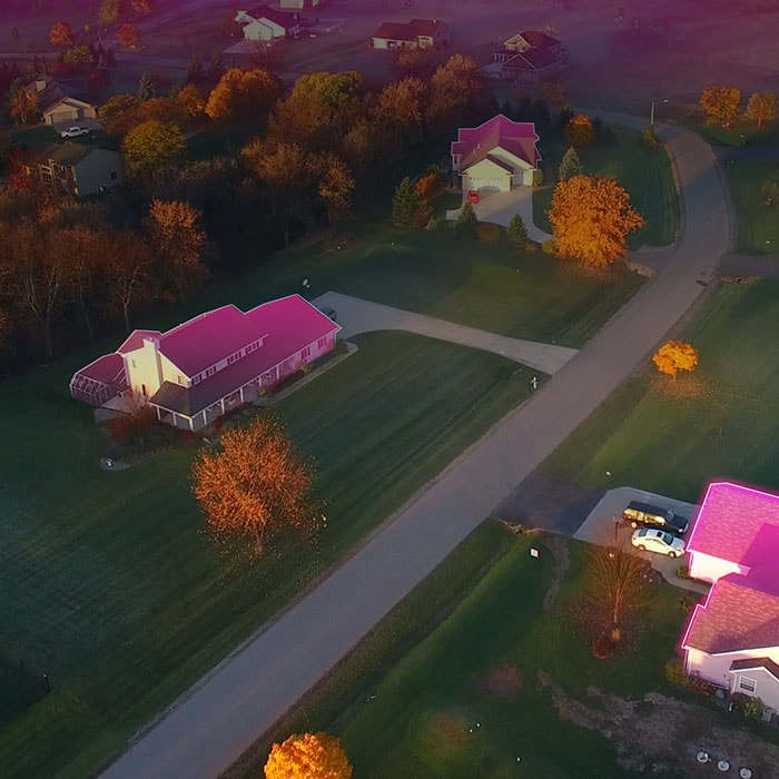Rural homes with glowing magenta roofs