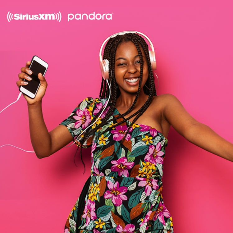 Woman dancing to music from Pandora with headphones on